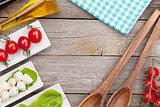 Fresh healthy salad, tomatoes, mozzarella on wooden table
