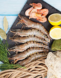 Fresh raw tiger prawns and fishing equipment
