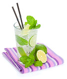 Fresh mojito cocktail and limes with mint