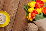 Colorful tulips bouquet and coffee cup