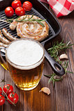 Beer mug and grilled sausages