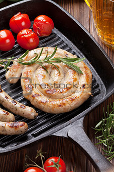 Grilled sausages and beer mug