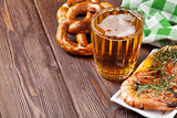 Pretzel, beer mug and grilled shrimps