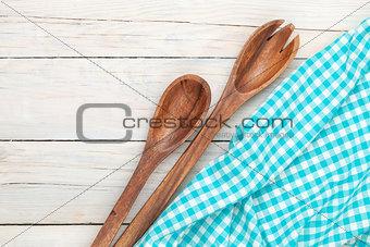 Kitchen utensil over white wooden table background