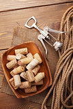 Bowl with wine corks and corkscrew