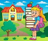 Girl holding books theme image 2
