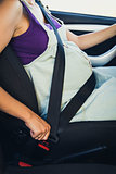 Pregnant woman wear safety belt