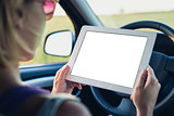 Woman using tablet pc in the car