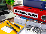 Red Ring Binder with Inscription Training Plan.