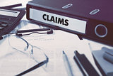 Claims on Ring Binder. Blured, Toned Image.