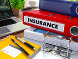 Red Ring Binder with Inscription Insurance.