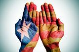 man hands patterned with the Catalan pro-independence flag