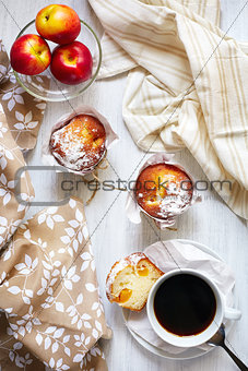 Breakfast table with cakes, coffee and fruits