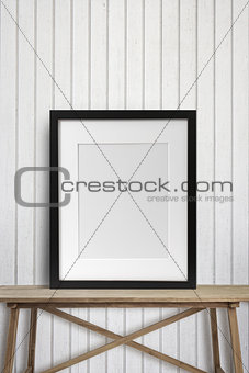 Black picture frame on wood table