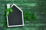House shaped chalkboard on Christmas background