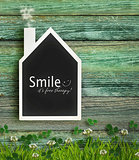 House shaped chalkboard on wood