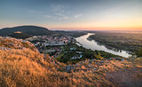 View of Small City with River from the Hill at Sunset