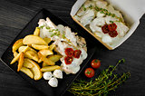 Delicious portion of rustic potatoes fillet with aromatic herbs