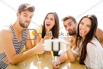 Group selfie at the beach bar
