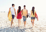 Friends walking at the beach