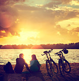 Romantic Couple with Bikes by the Lake