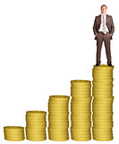 Businessman on golden coins stack