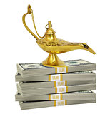 Golden lamp on bundle of money