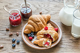Croissants with fresh berries and jam