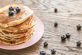 Pancakes with maple syrup and fresh blueberries