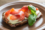 Sandwich with trout, mozzarella and tomatoes