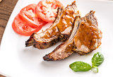 Portion of grilled pork ribs in barbecue sauce