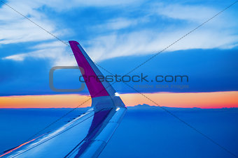 Airplane Wing Seen Through Porthole Window