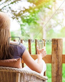 Calm woman relaxing outdoors