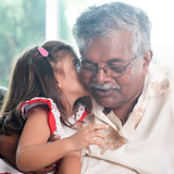 Granddaughter kissing grandfather