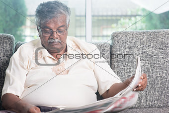 Old people reading newspaper