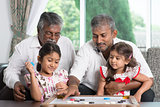 Multi generations family playing games