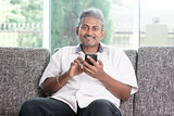 Indian man using smart phone