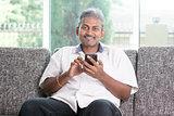 Indian man using smart phone