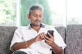Indian man using smartphone