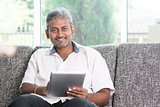 Indian using touch screen tablet pc