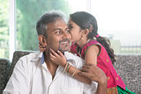 Daughter kissing dad