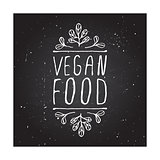 Vegan food - product label on chalkboard.