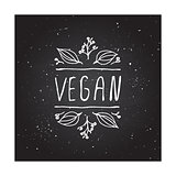 Vegan product label on chalkboard.