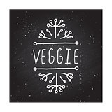 Veggie product label on chalkboard.