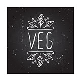 Veg product label on chalkboard.