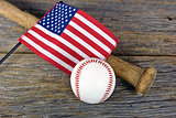 flag on baseball bat with ball