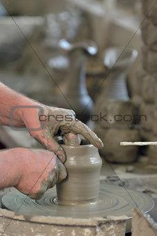 Potter's hands making a pot
