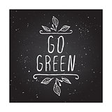 Go green - product label on chalkboard.