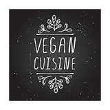 Vegan Cuisine - product label on chalkboard.