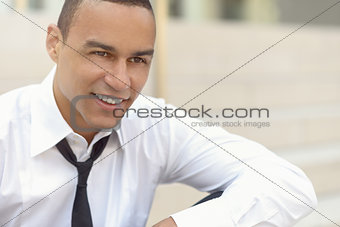 Attractive smiling businessman with a loosened tie